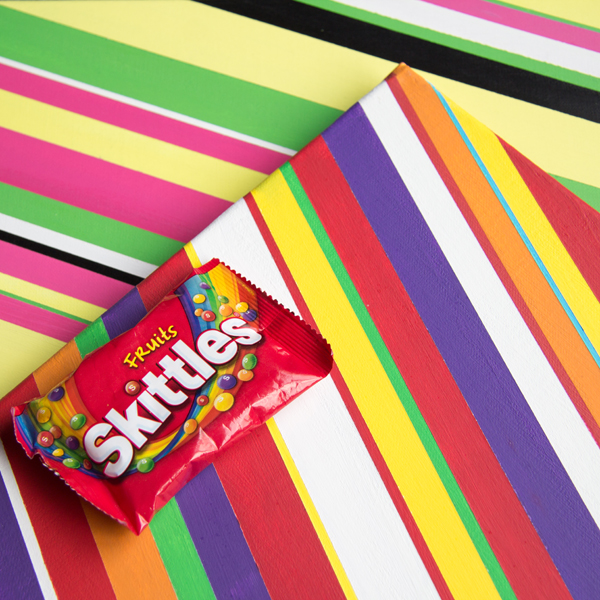 Malabar and Skittles artpieces along with a bag of Skittles